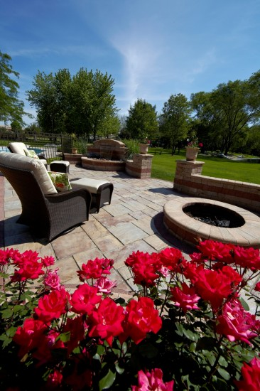 Outdoor Living Patio with Fire pit and wall featuring Avante Ash