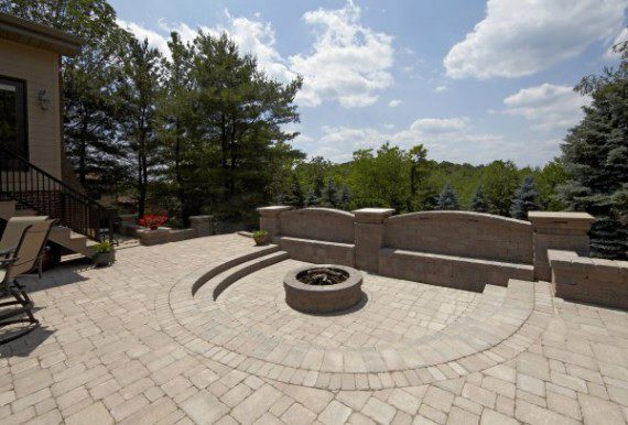 Outdoor Living Patio with Fire Pit and wall using Brussels Block paver