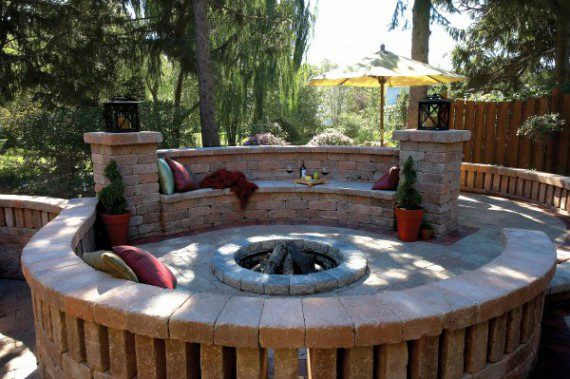 Patio seat wall and fire pit featuring Olde Quarry paver
