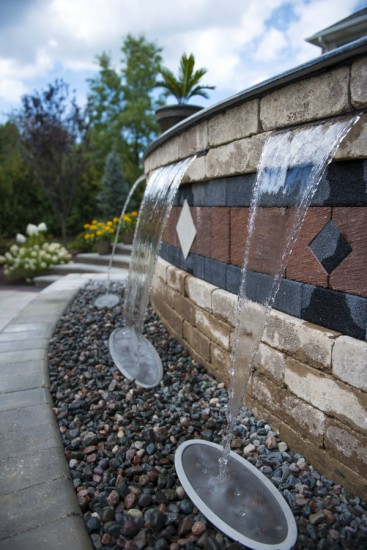 Wall and water feature using Unilock Brussels Dimensional paver