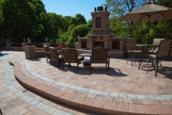 Umbriano and Copthorne paver patio with fireplace by Unilock