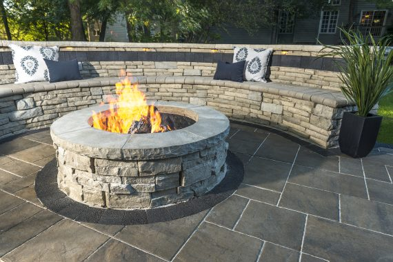 Patio With A Rivercrest Fire Pit Kit And Seating Wall Photos